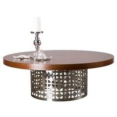"""Showcasing a stainless steel openwork base and round top, this elegant coffee table adds a cosmopolitan touch of style to your living room or library.  Product: Coffee tableConstruction Material: Stainless steel and woodColor: BrownDimensions: 13"""" H x 22"""" Diameter"""