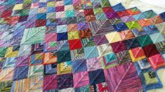 Ravelry: Sock Yarn Blanket pattern by Shelly Kang. I've made a blanket like this before, but with huge squares, it would be fun to use up scraps and make this!