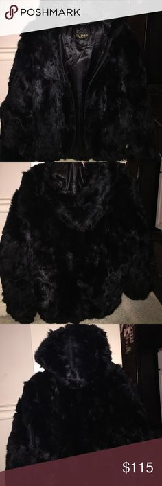Tim Baker Black Fur Coat Gorgeous black fur coat by the known Tim Baker. Authentic vintage design from the well known designer. Perfect for the cold weather or when you are just wanting to look stylish. This look is timeless and can go well in any kind of cold weather. Over sized coats are trendy, so if you have a small frame you can do the off the shoulder look. This is a size medium, and it goes perfect if you are 170lbs like myself. Diverse features for this beautiful coat. tim baker…