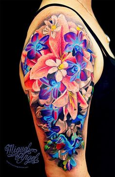 Vivid shoulder and upper arm sleeve flower tattoo. Click to discover more Sensational Flower Tattoos.