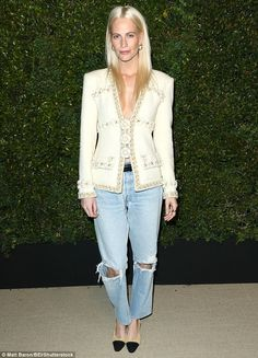 Need for tweed: Poppy Delevingne ensured all eyes were on her as she arrived at a Chanel d...