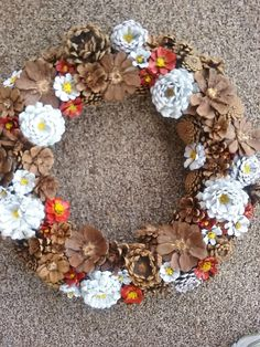 beautiful hand painted, hand cut pinecone wreath, this is made from New Mexico pinecones . The wreath measures approximately 22 inches across and about 60 inches in circumference . No sprays or preservatives have been used.