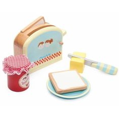 Honeybake Toaster Set by Le Toy Van. The Le Toy Van Honeybake Toaster Set contains a spring-loaded pop-up toaster with 2 slices of toast, a butter pat with velcro, Kids Role Play, Pretend Play, Toy Kitchen Accessories, Van Kitchen, Pop Up Toaster, Pretend Kitchen, Done By Deer, Tee Set, Baking With Honey