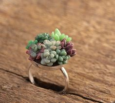 A ring made up of tiny, faux succulents - SO original and beautiful!