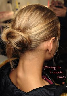 Begin with dry hair. Run brush through to smooth out tangles, & apply anti-frizz serum.2.Part hair down centre, & brush it into a low ponytail. Secure at the nape of neck. 3. Wrap ponytail around its base. Tie a second elastic around bun.4. Secure sides of bun with bobby pins, tucking them into the bun, to pull it closer to your head and conceal any elastic that may be showing.5. Using fingers, pull small strands of hair out of bun, for messy effect. To set, spray bun lightly with hairspray.