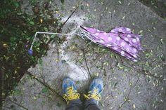 Looking down at a broken umbrella. by Lucas Saugen