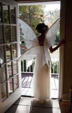 Why We Love It: The bride wore fairy wings down the aisle in this beautiful Halloween-themed wedding!