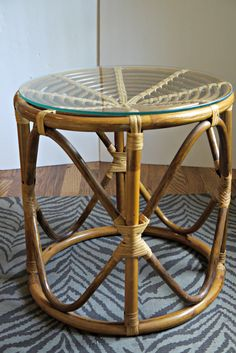 Vintage Mid Century Bentwood Glass Top Bamboo Side Table Rattan Round. $78.00, via Etsy.