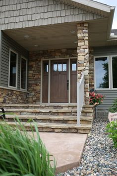 Exterior Doors | craftsman style entry door with sidelites accented with stone | Bayer Built Woodworks