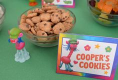 If you are having a Trolls party, what about setting up a Trolls themed snack bar? These fun party food cards are an easy way to do just that and it works well for party food, or a way to allow party guests to fill up a bag with their favorite Trolls treats to take home and enjoy!