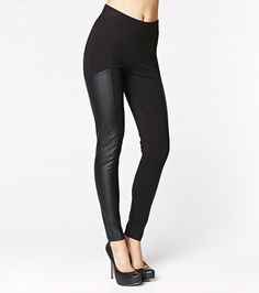 Leggings with a leather panel.