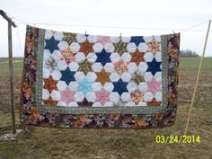 New/old quilt. This is a quilt top sewed by my great Aunt Dora before 1972.  I quilted it and put the border on it..