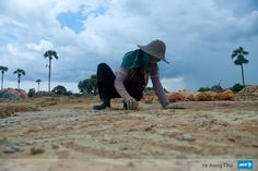 Woman collects the copper near the Monywar , Myanmar.