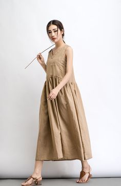 Cool and comfortable for hot summer days, this natural linen loose-fitting beige linen dress is elegant and stylish. It is a wonderful wardrobe staple thats a timeless classic youll wear again and again. You can dress this up or down depending on which occasion youre going to. Wear it with heels, a silk scarf and pearl jewelry for a really elegant and smart event or you can dress it down with flats, chunky boho jewelry accessories and a large leather handbag for more informal dates. You may…