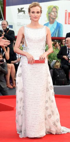 Diane Kruger dropped jaws at the Everest premiere during the 2015 Venice Film Festival in a white Prada column that boasted metallic threadwork and an exquisite embroidered train. She styled the stunner of a dress with Kwiat diamonds and a silver mirrored Lee Savage clutch.