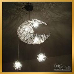 """A lighted mobile hung above the bed, casting shapes of the moon and stars over the ceiling."" #CrystalKingdom"