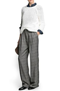 The Gangster Pant — Exaggerated menswear shapes feel so luxurious — especially in Prince of Wales plaid and, yes, even when it costs less than dinner for two.  Mango Prince of Wales Palazzo Trousers, $39.99, available at Mango.