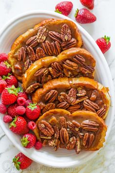 This Caramel French Toast recipe will spoil you forever. The combination of caramel sauce with crisp bacon and pecan topping, is memorable. #frenchtoast #caramelfrenchtoast #bacon #pecan #frenchtoastrecipe #breakfast #brunch #natashaskitchen