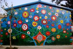 Tree of Life mural for the Dandelion Middle School on the outskirts of Beijing. Designed by Lily Yeh. Painted by students.Dandelion Tree of Life mural for the Dandelion Middle School on the outskirts of Beijing. Designed by Lily Yeh. Painted by students. Mural Painting, Mural Art, Wall Murals, Murals Street Art, Painted Shed, Painted Fences, Renovation Facade, Garden Mural, Flower Mural
