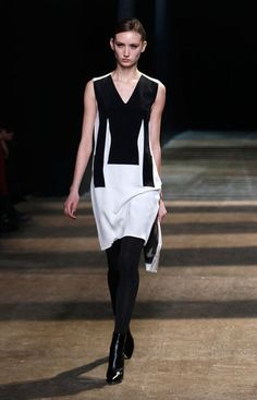 """Phillip Lim employed the use of some cleverly-placed panels and a little optical trickery for Fall 2012. The designer said he was interested in """"using positive and negative space to evoke neo-noir heroines"""" and to that end, there was plenty of cool duality to be found here. Crisply tailored separates were kept to a strict palette of neutrals and jeweltones, high-contrast textures were used throughout, and a fog machine on the runway gave it all a graphic-novel effect."""