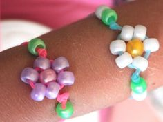 Daisy Flower Bracelet (These look like Dora the Explorer bracelets).  Gotta try making these with my daughter.