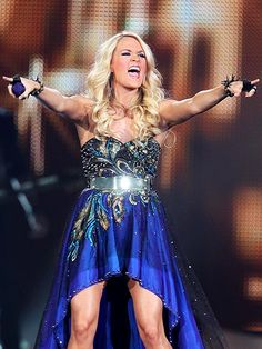 Carrie Underwood rocks out for the crowd in Canada.  http://www.people.com/people/gallery/0,,20635807,00.html#