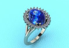 Michael Rousso Custom designed star sapphire setting with cluster diamond halo.