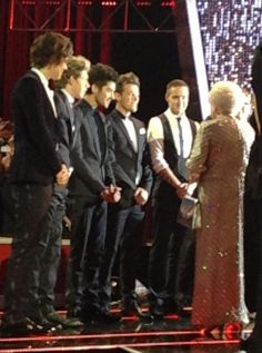 The boys meeting the Queen! Hahahahah look at them standing all upright with their hands like that...