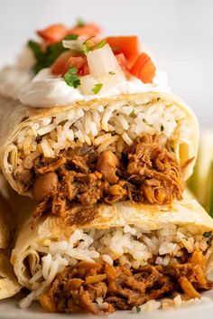 These incredibly good shredded beef burritos are filled with cilantro rice, (slightly) spicy beans, and fall-apart tender beef. Freeze the the extras for quick and easy lunches and dinners! Shredded Beef Burritos, Freezer Burritos, Shredded Chicken, Cilantro Rice, Lunches And Dinners, Fajita Vegetables, Recipes Using Pork, Beef Recipes For Dinner, Chipotle Pepper