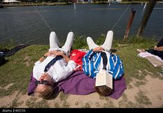 Henley on Thames, Oxfordshire, UK 3rd July 2014. The #HenleyRoyalRegatta. The banks of the Thames were filled with picnicers as temperatures neared 26 degrees the hottest day of the year so far. © Allan Staley/Alamy Live News