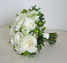 Beautiful pale green and white colour scheme and a look that manages to be both modern and classic.