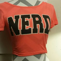 Crop top Nerd tee Crop top....NERD! Declare your nerdiness with this tee. Orange overall, black letters outlined with white. Charlotte russe, size small. Charlotte Russe Tops Crop Tops