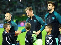 Marc-Andre ter Stegen of Barcelona taps hands with a mascot before the UEFA Champions League group C match between VfL Borussia Moenchengladbach and FC Barcelona at Borussia-Park on September 28, 2016 in Moenchengladbach, North Rhine-Westphalia.