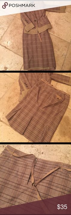 Smart and sharp khaki plaid BCBG Maxazria suit Look sharp and stylish in this BCBG Maxazria suit. Khaki and darker brown plaid material, it's he details that make it special- such as the khaki cutaway back, the back pleat on the skirt etc. well worn but still lots of life yet, GUC. Ask questions today! BCBGMaxAzria Skirts Skirt Sets
