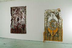 Elana Herzog,Civilization and its Discontents,2003, installation view at Smack Mellon, Brooklyn, New York, Persian and Persian type carpets, mixed fabrics, metal staples.From elanaherzog.com.