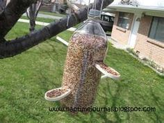 a 2 liter bottle and 2 wooden spoons... let the kids make a bird feeder!