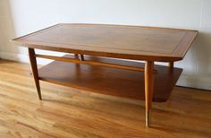 Mid century modern surfboard coffee table from the Lane Copenhagen collection with brass tipped tapered legs