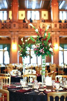 Love the tall centerpieces that add some color to the table settings. Makeup Salon, Centerpieces, Table Decorations, Cathedral, Amy, Wedding Flowers, Table Settings, Reception, The Incredibles