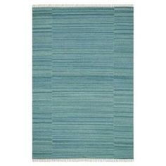 Stylishly anchor your living room seating group or master suite ensemble with this flatweave wool rug, showcasing aqua striping and fringed ends.   Product: RugConstruction Material: 100% WoolColor: AquaFeatures:  FlatweaveMade in IndiaFringed details Hand-wovenNote: Please be aware that actual colors may vary from those shown on your screen. Accent rugs may also not show the entire pattern that the corresponding area rugs have.Cleaning and Care: Clean spills immediately by blotting with a…