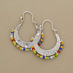 """A unique assortment of African beads outlines each of Naomi Herndon's hand hammered, self-locking hoops. Sterling silver. Exclusive. Made in USA. 1-3/8""""L."""