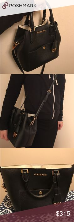 Black Michael Kors Bucket bag, only used twice Basically brand new! I got it as a gift two summers ago and only used it a couple times before I got a bigger bag that suited me better. It's pristine on the outside, absolutely no scuffs or scratches (including the bottom). The inside is in good condition too, the only flaw is that a lipstick popped open and left marks which are almost completely gone, leaving some hardly noticeable discoloration. The shoulder strap is removable. Since this was…