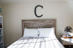 Rustic headboard. Paint white. Then scrape or remove much of the paint. Brew 8 teabags & apply tea to the wood. Make vinegar stain by placing several steel wool pads in a jar/ cover with vinegar & let sit a couple days. Apply to wood (2) coats, let dry. Remove residue with a wet rag. Use Annie Sloan furniture wax to seal