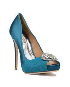 Pettal Crystal Pump - Style # : PETTAL - TEAL - $245.00 - Pettal by Badgley Mischka. Pettal is a beautiful satin evening pump that shines with a glamorous rhinestone decoration at the toe. The platform toe stablilizes the shoe and makes the heel feel lower. The Pettal platform is covered with a sheer fabric at the peep toe that adds an exotic appeal to this stunning style. - Heel height: 4 3/4 inches. - Sale price is only applicable to online purchases and not valid in Badgley Mischka…
