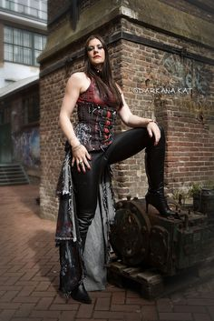 FLOOR JANSEN - Photo by DARKANA KAT - © DARKANA KAT 2013 Here another picture of Floor Jansen by Darkana Kat - Music Photography. This was the first part of the photoshoot together in Roermond. She was wearing an amazing outfit and I took the photos in the outside, in a cool place. I really like this outfit, made by Ingeborg Steenhorst. And again: thanks for your help, Mc Sharq Btw, people: NO EDIT THE PICTURE AGAIN, DON'T DELETE MY NAME IN THE PHOTO and RESPECT MY COPYRIGHT! MY CREDITS…