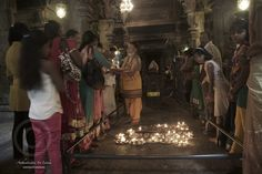 Hindu devotees seeking blessings from the Possari or Hindu priest