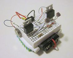 """Does your robot move towards or away from bright light? In the """"Build a Light-Tracking Robot Critter"""" #robotics #science project, students make a small dual-motor robot that responds to light--much like some animals and insects do! [Source: Science Buddies, http://www.sciencebuddies.org/science-fair-projects/project_ideas/Robotics_p012.shtml?from=Pinterest] #STEM #scienceproject #engineering"""