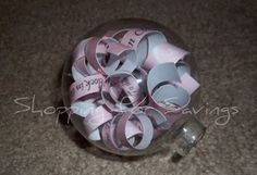 really cute gift idea for a couple's first wedding anniversary- cut out strips from their wedding announcement, place them inside a glass ornament and you have a super cute christmas ornament or keepsake. :)