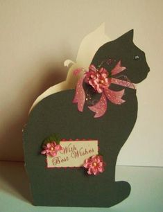 Cat with Bow Shaped Card on Craftsuprint created by Betty Aldred - Printed onto good quality white card, cutout image.Folded in half, added glitter to ribbon, and flower, added sentiment amd 2 flowers, and a beady eye.