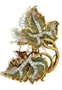 Plique-à-jour enamel and diamond leaf brooch, Marcus & Co., circa 1900. The double-leaf motif of shaded green plique-à-jour enamel accented with small old-mine and single-cut diamonds, mounted in 18 karat gold and platinum, signed Marcus & Co.