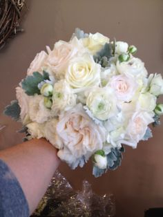 BRIDAL BOUQUET WITH RANUNCULUS, GARDEN ROSES, HYBRID TEA ROSE, HYDRANGEA, AND DUSTY MILLER. CALL US FOR DETAILS AT 573-443-8719